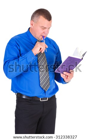 Portrait of a thinking business guy writing in his organizer. Successful businessman in blue shirt and tie looking in notebook. Isolated white background, Concept of leadership and success - stock photo