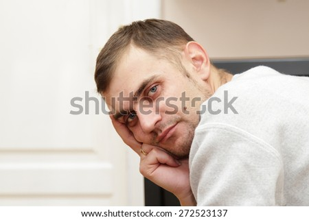 Portrait of a thinking young man - stock photo