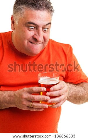 Portrait of a thirsty fat man staring at a glass of beer isolated on white background - stock photo