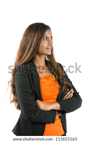 Portrait of a thoughtful Indian Business woman looking to her right.  Isolated on white background. - stock photo