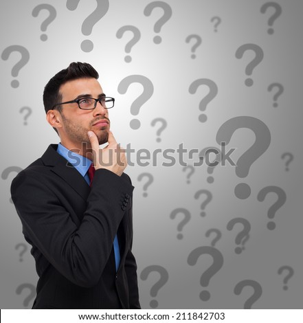 Portrait of a thoughtful man having doubts - stock photo