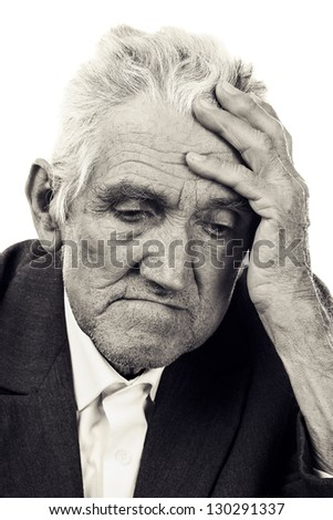 Portrait of a thoughtful old man on white. Black and white - stock photo
