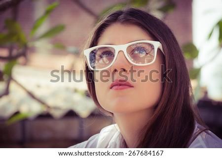 Portrait of a thoughtful teenage girl - stock photo