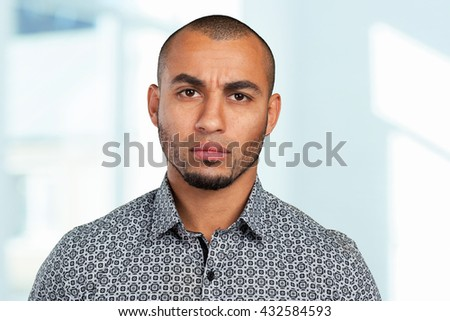 Portrait of a thoughtful young businessman - stock photo