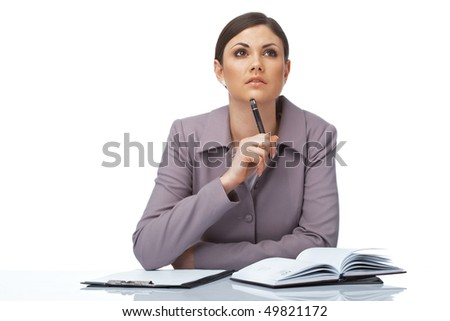 Portrait of a thoughtful young businesswoman with pen and notebook - stock photo