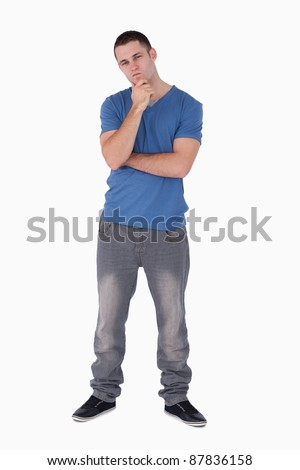 Portrait of a thoughtful young man against a white background - stock photo