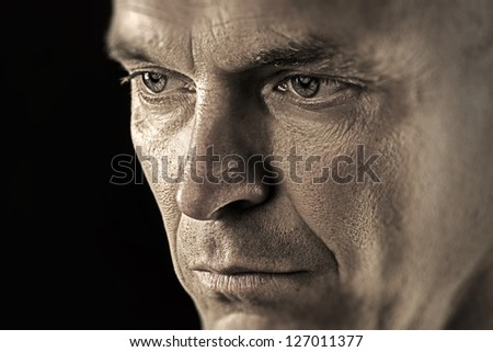 Portrait of a thoughtfully and serious man - stock photo