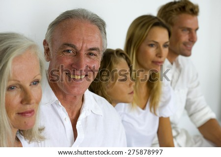 Portrait of a three generations family. - stock photo