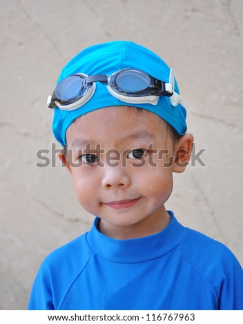 Portrait of a Three years old boy with swimming accessories - stock photo