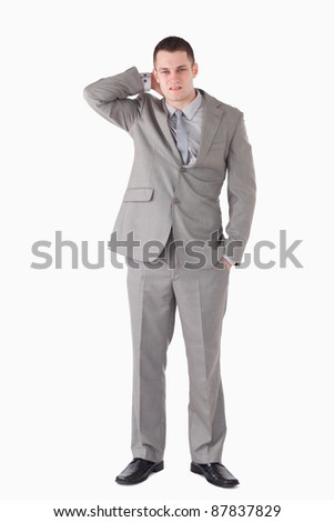 Portrait of a tired businessman against a white background - stock photo