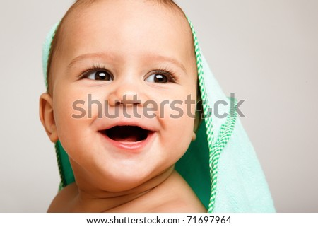 Portrait of a toothless baby laughing - stock photo