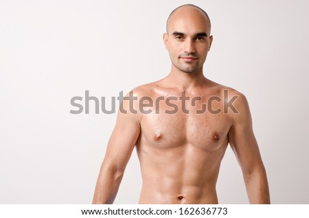 Portrait of a topless man. Man showing his fit body with six pack abs. - stock photo