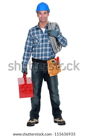Portrait of a tradesman with his tools - stock photo