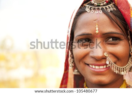 Portrait of a traditional clothing Indian smiling - stock photo