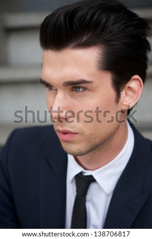Portrait of a trendy young businessman - stock photo