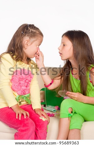 portrait of a two little girls on sofa - stock photo