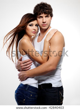 Portrait of a two young beautiful embracing lovers - stock photo
