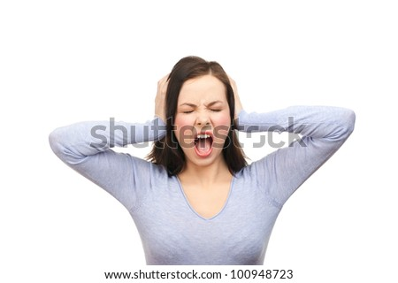 Portrait of a unhappy young woman covering her ears and screaming. Isolated on white background - stock photo