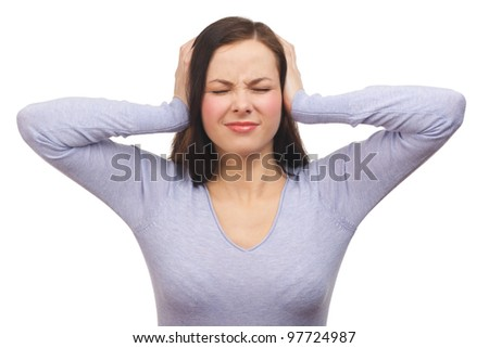 Portrait of a unhappy young woman covering her ears. Isolated on white background - stock photo