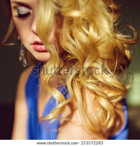 Portrait of a very attractive, sensual blue-eyed blonde with hair that shines in the sunlight - stock photo