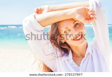 portrait of a very beautiful natural caucasian woman on a beach - stock photo