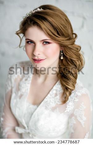 portrait of a very beautiful sensual girl bride in wedding dress - stock photo