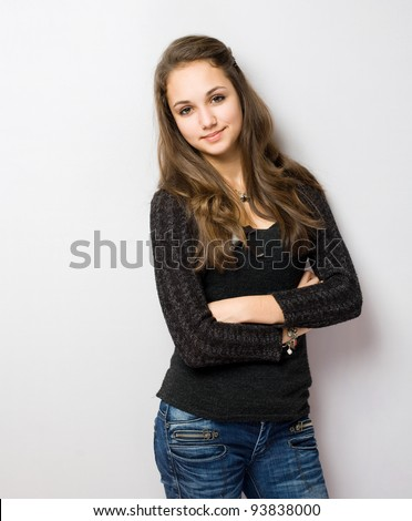 Portrait of a very confident looking young brunette. - stock photo