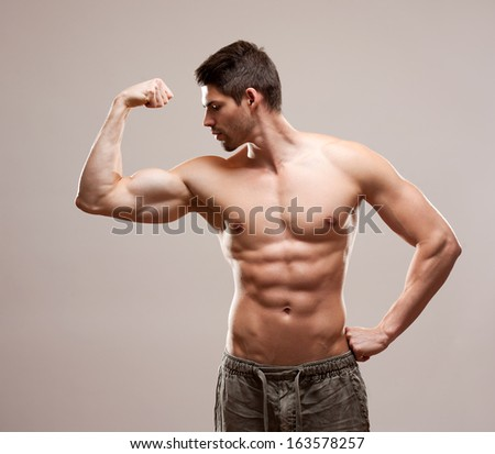 Portrait of a very fit handsome young athlete. - stock photo