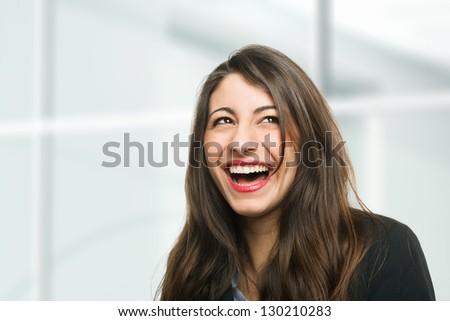 Portrait of a very happy woman laughing - stock photo