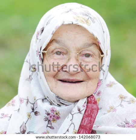 Portrait of a very old woman outdoor - stock photo