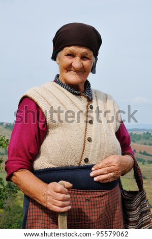 Portrait of a very old woman outdoors - stock photo
