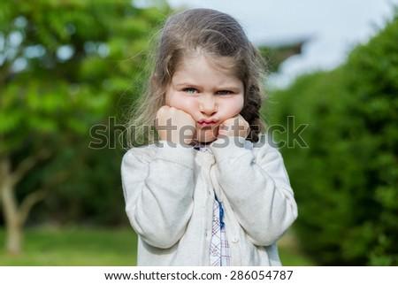 Portrait of a very sad girl - stock photo