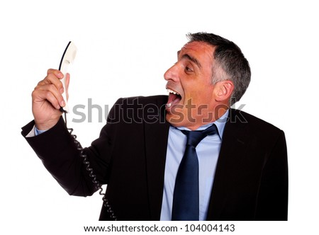 Portrait of a very stressed latin business man laughing with a phone against white background - stock photo