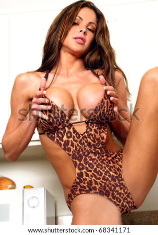 Portrait of a voluptuous woman in animal print bikini - stock photo