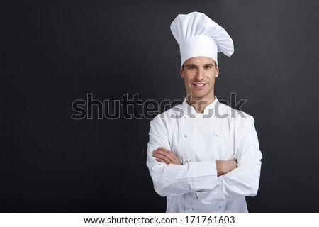 Portrait of a waiter holding a waine bottle - stock photo