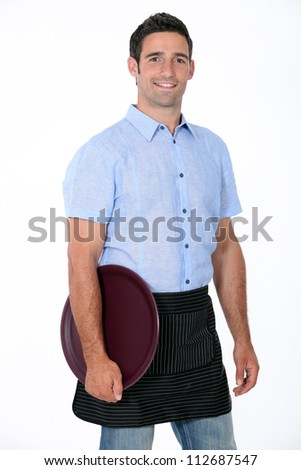 Portrait of a waiter with his tray - stock photo