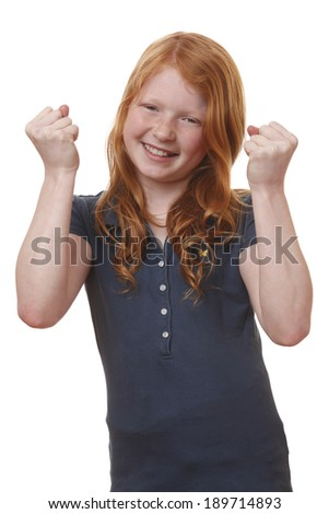 Portrait of a winning young girl on white background - stock photo