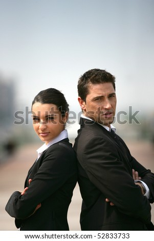 Portrait of a woman and a man back to back - stock photo