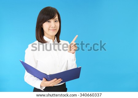 Portrait of a woman doing a presentation - stock photo