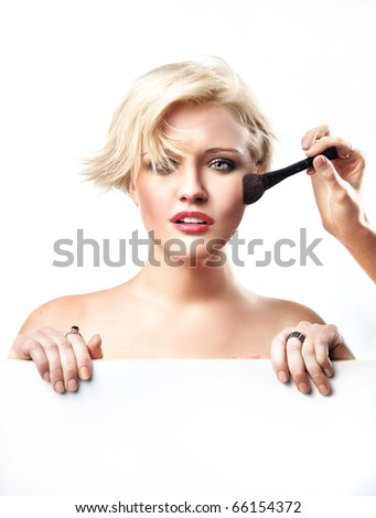 Portrait of a woman doing make up - stock photo