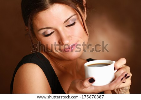 Portrait of a woman drinking coffee - stock photo