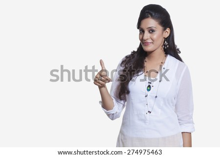 Portrait of a woman giving thumbs up sign - stock photo