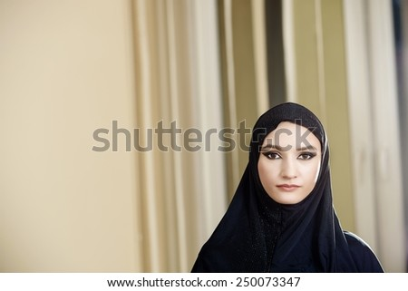 Portrait of a woman in a hijab while working in the office - stock photo