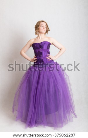 portrait of a woman in a purple evening gown - stock photo