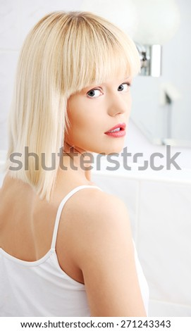 Portrait of a woman in bathroom. - stock photo