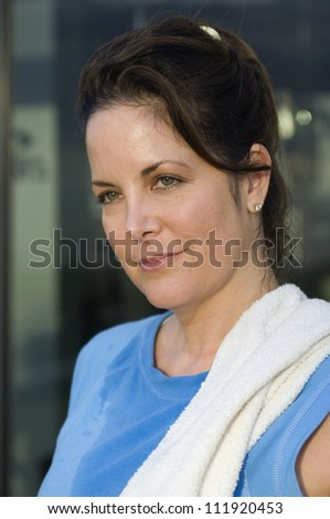 Portrait of a woman in gym - stock photo