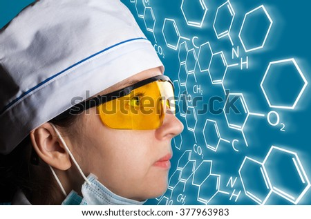 portrait of a woman in uniform on blue background - stock photo