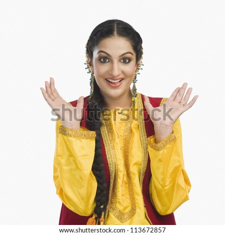 Portrait of a woman in yellow Punjabi dress - stock photo