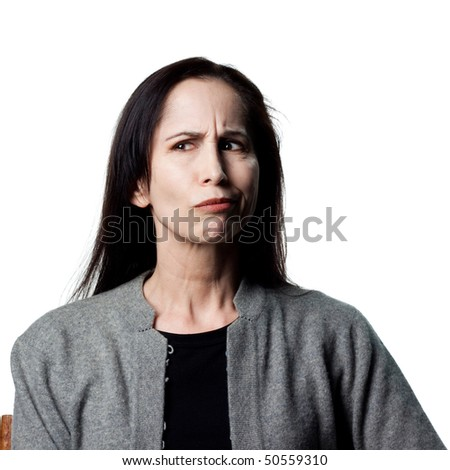Portrait of a woman making a hard decision - stock photo