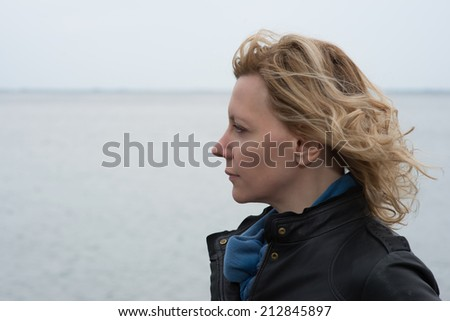 Portrait of a woman on a windy day - stock photo